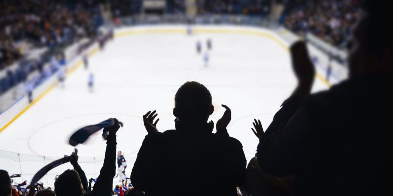 Ice hockey rink and fans cheering