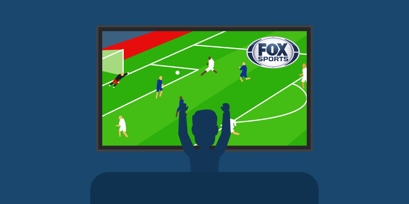 Person raising his arms while watching a soccer match n Fox Sports