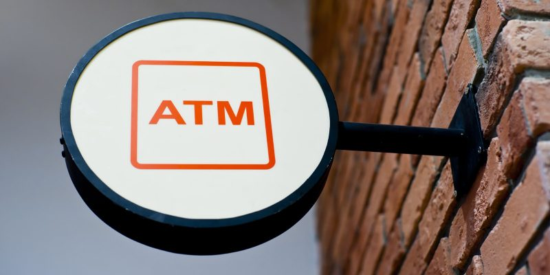 ATM sign on building