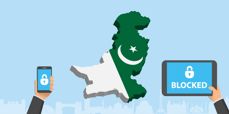 Map of Pakistan with two hands holding a blocked tablet and smartphone next to it