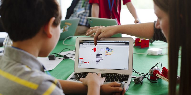 Children learning how to code with Scratch