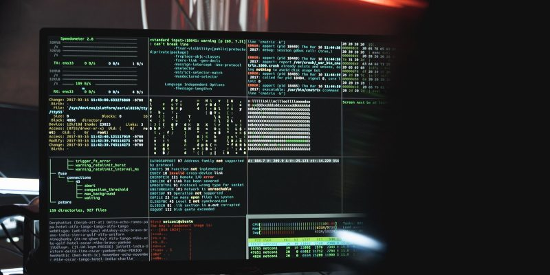 Close up of a screen with multiple tables of code with a shadow figure on the right
