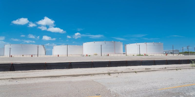 Fuel storage tanks with stairs against blue sky -Cyberattack Paralyzes the United States' Major Fuel Pipeline