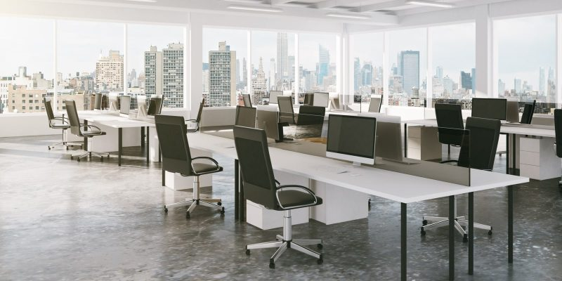 Modern open space office with city view - empty desks