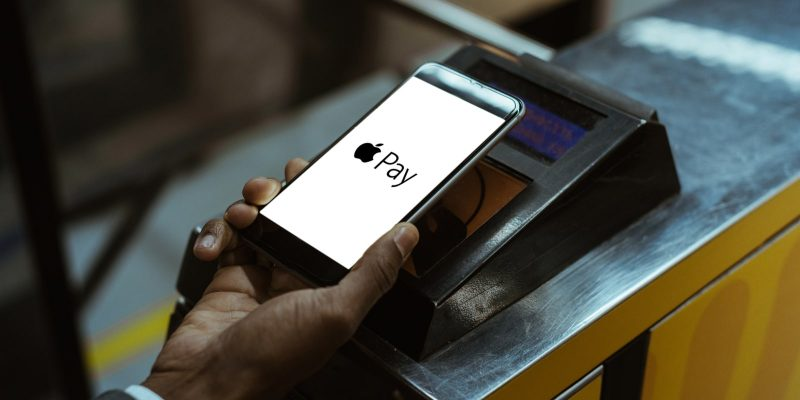Device with Apple Pay logo on a white background making a contactless payment
