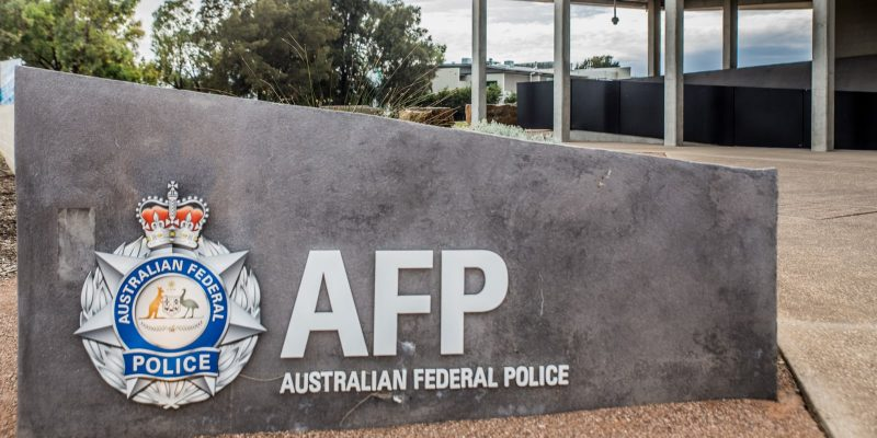 Australian Federal Police (AFP) logo on the wall of a police station in Australia