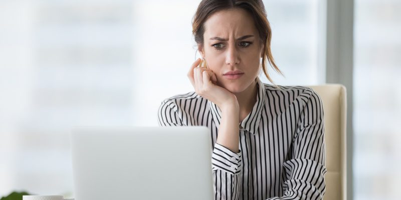 Confused woman on the computer
