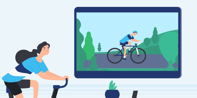 Woman on bike watching Tour de France on television