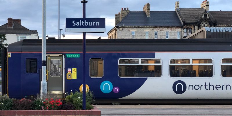 Northern train arriving in train station in the UK. Hundreds of rail ticket machines in Northern England still offline due to a cyberattack