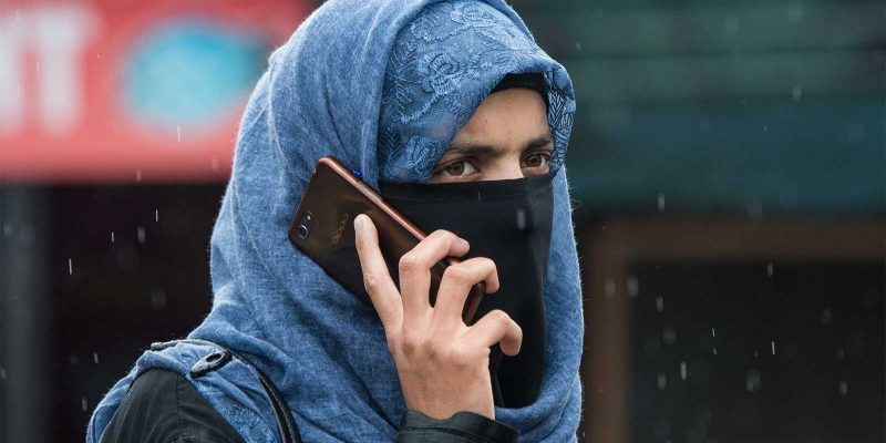 Kashmiri woman on phone