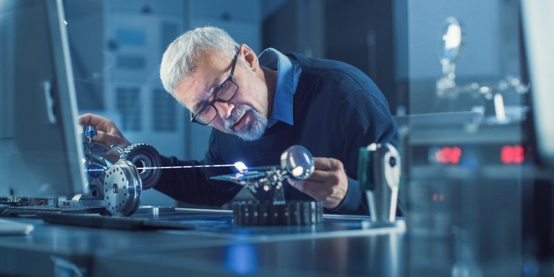 Researcher working with laser