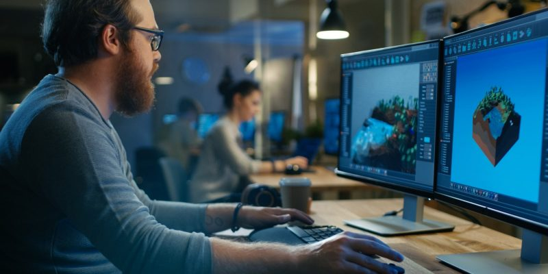 Male Game Developer Works with Graphics for the New Level Design