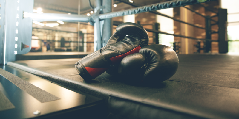 Boxing gloves on the floor of a ring
