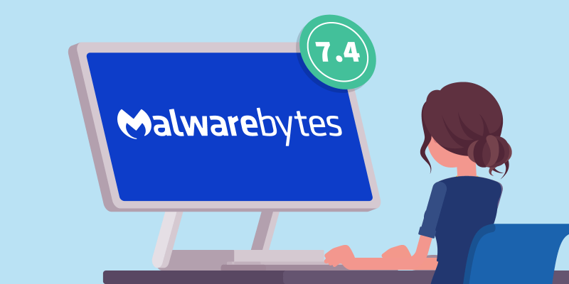 Woman sits behind computer screen that shows the name Malwarebytes with a score of 7.4 in the corner