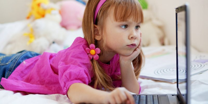 Child playing on computer