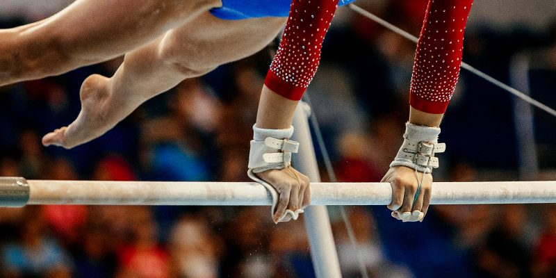 uneven bars athlete gymnast to competition in artistic gymnastics