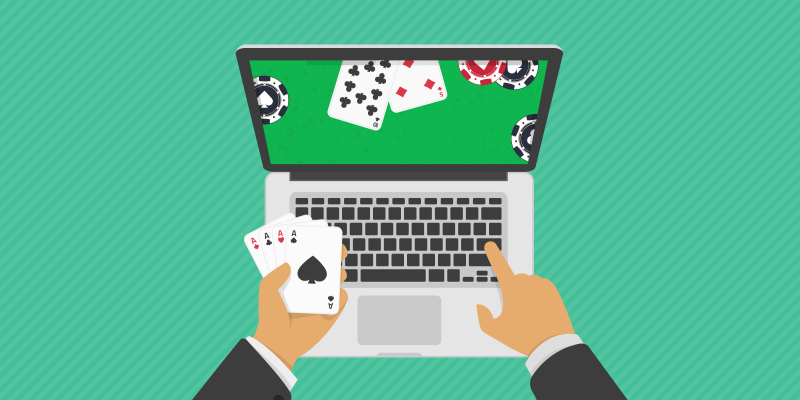 Person holding playing cards playing poker online