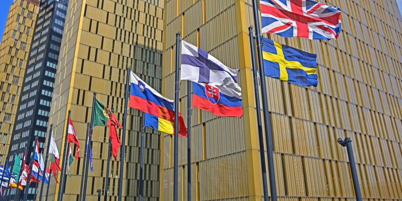 Flags of the European Union countries in front of the Court of Justice of the European Union