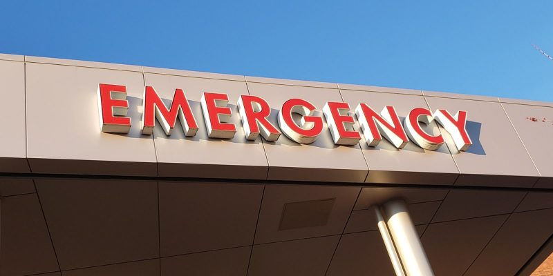 Emergency Room in red letters over entrance of a US hospital