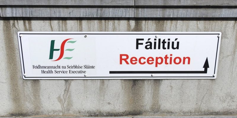 Drogheda, County Louth, Ireland. HSE Reception entrance wall sign in English and Irish language.