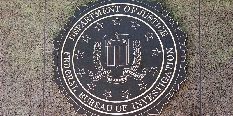 Department of justice sign on building FBI