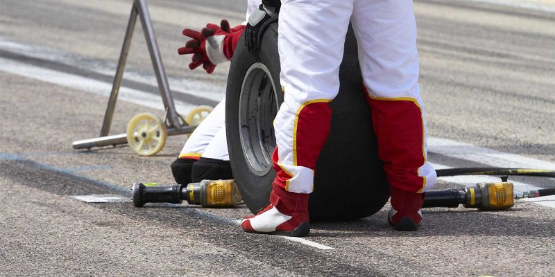 F1 Pit crew member holding a tire